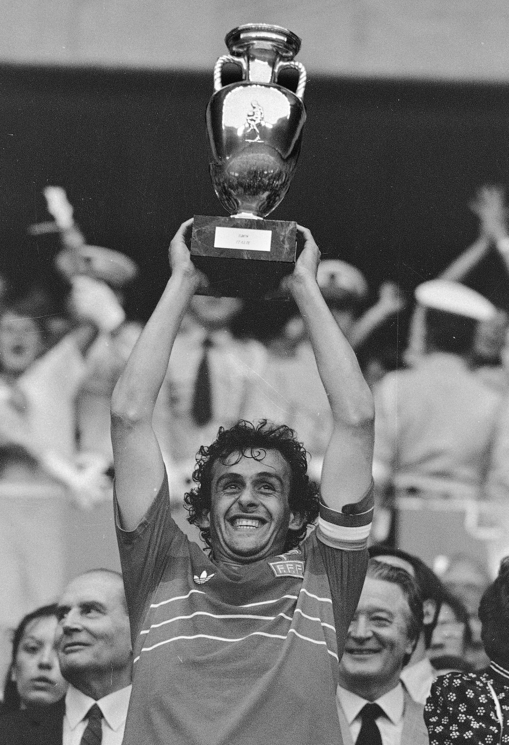 FILE - In this file b/w photo dated June 27, 1984 French team captain Michel Platini holds high the winner's cup after France beat Spain, 2-0, in the