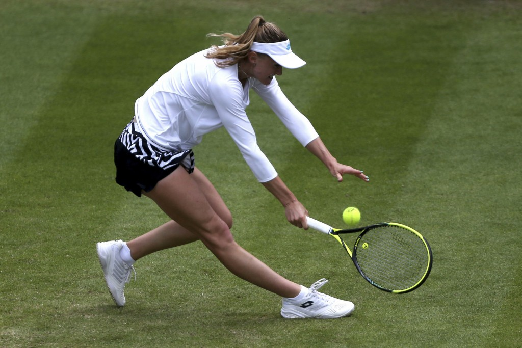 Belarus' Aliaksandra Sasnovich, returns a shot to Venus Williams of the US during day five of the Birmingham Classics, at Edgbaston Priory Club, in Bi...