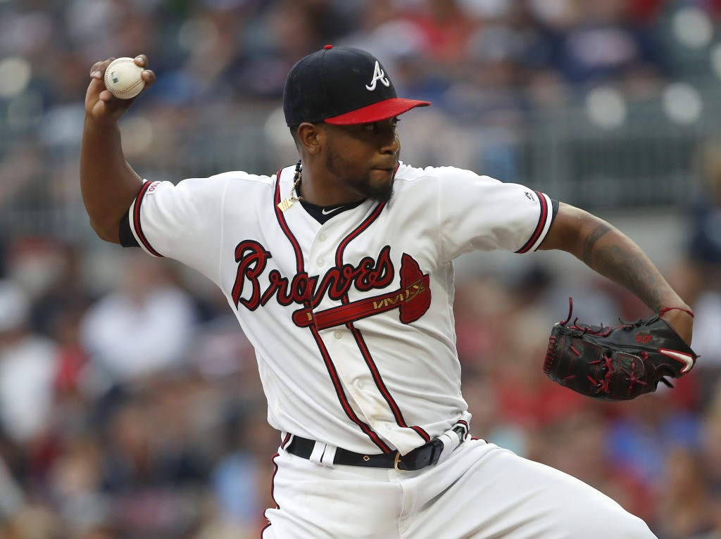 Atlanta Braves starting pitcher Julio Teheran (49) works against the New York Mets in the first inning of a baseball game Tuesday, June 18, 2019, in A
