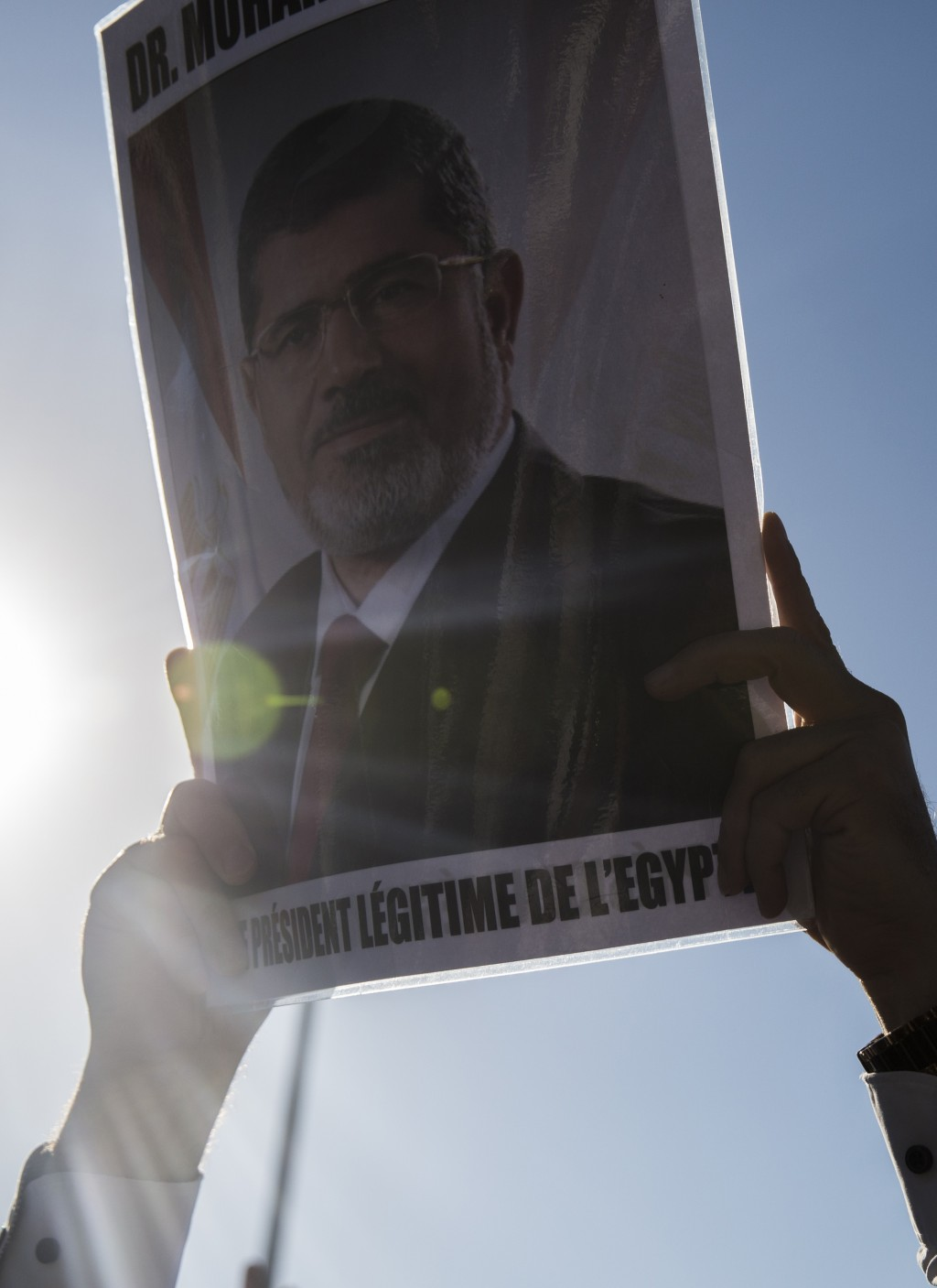 A man holds a picture of ousted former Egyptian President Mohammed Morsi in Tunis, Tunisia. Tuesday, June 18, 2019. The former president, who was oust...