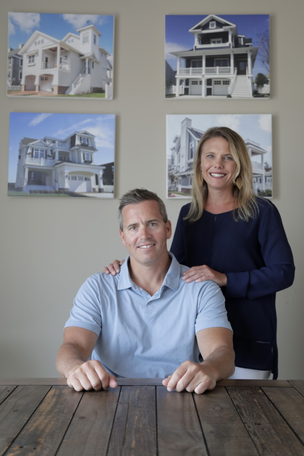 In this Wednesday, June 5, 2019, photo, Chris Carr, left, president of McLaughlin Construction Management, poses for a photo with his wife Kristy Carr...