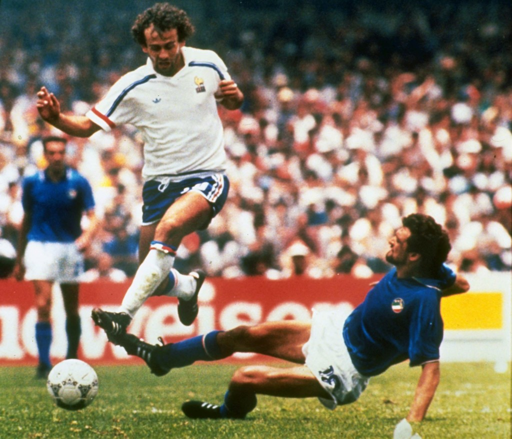 FILE - In this file photo dated  June 17, 1986, Michel Platini, left, of France dribbles past Italian forward Alessandro Altobelli in their World Cup