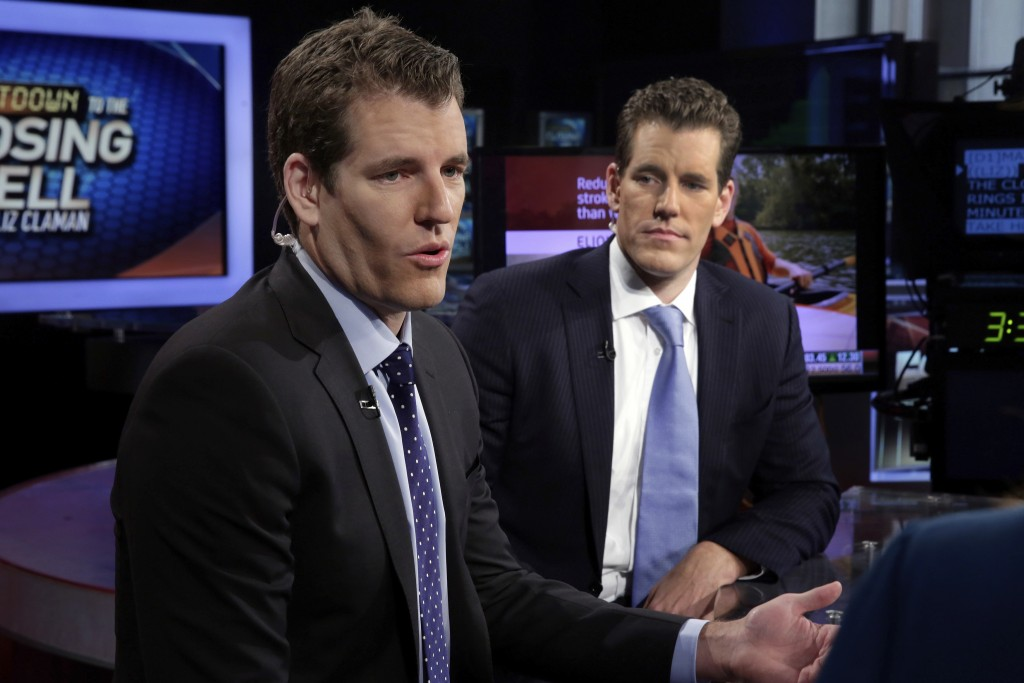 FILE - In this Thursday, Oct. 8, 2015 file photo, Tyler Winklevoss, left, and Cameron Winklevoss, founders of Gemini Trust Co., appear on the Fox Busi...