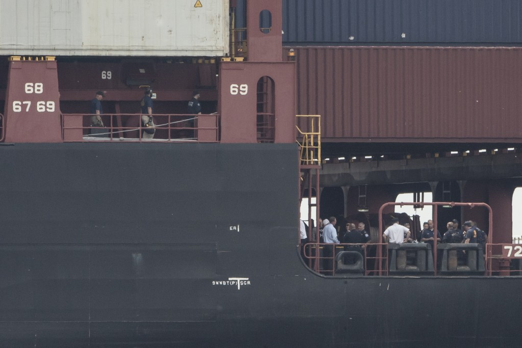 Officials gather on the decks of the MSC Gayane container ship on the Delaware River in Philadelphia, Tuesday, June 18, 2019. U.S. authorities have se