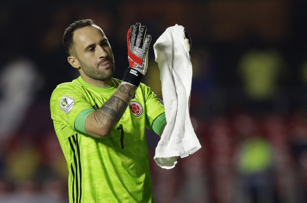 Colombia's goalkeeper David Ospina celebrates at the end of the Copa America Group B soccer match against Qatar at the Morumbi stadium in Sao Paulo, B...