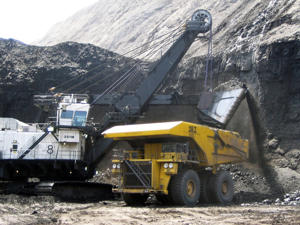 FILE - In this April 30, 2007, file photo, a shovel prepares to dump a load of coal into a 320-ton truck at the Arch Coal Inc.-owned Black Thunder min...