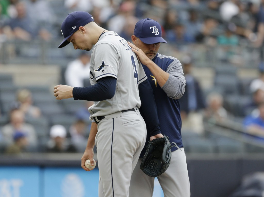 Tampa Bay Rays manager Kevin Cash, right, pulls starting pitcher Blake Snell from the game during the first inning of a baseball game against the New ...