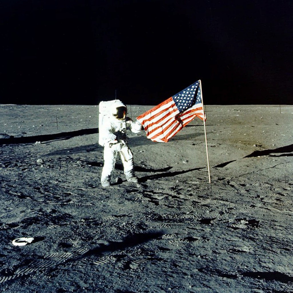 """FILE - In this Nov. 1969 photo made available by NASA, Apollo 12 mission Commander Charles P. """"Pete"""" Conrad stands on the moon's surface. A poll relea"""