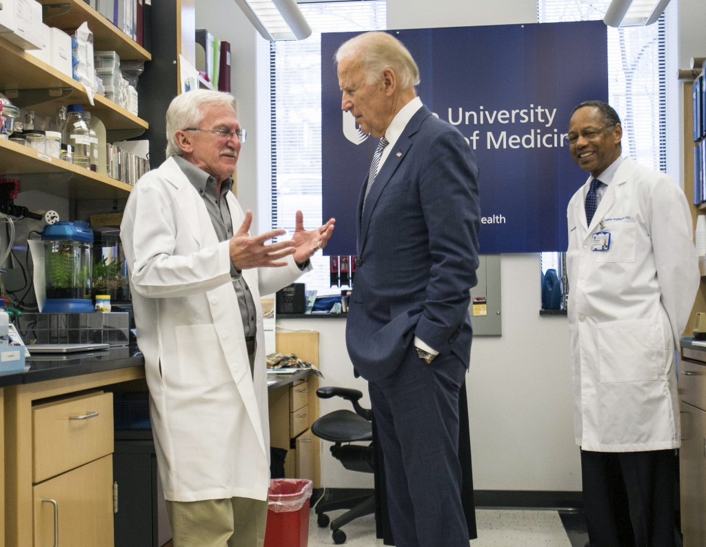 FILE - In this Feb. 10, 2016 file photo, Vice President Joe Biden speaks with Nobel Laureate Dr. Paul Modrich, left, as Dr. A. Eugene Washington, Chan...
