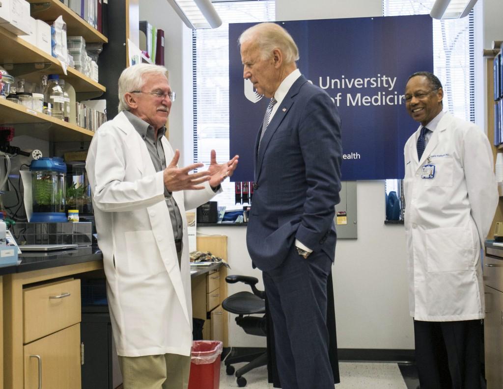 FILE - In this Feb. 10, 2016 file photo, Vice President Joe Biden speaks with Nobel Laureate Dr. Paul Modrich, left, as Dr. A. Eugene Washington, Chan