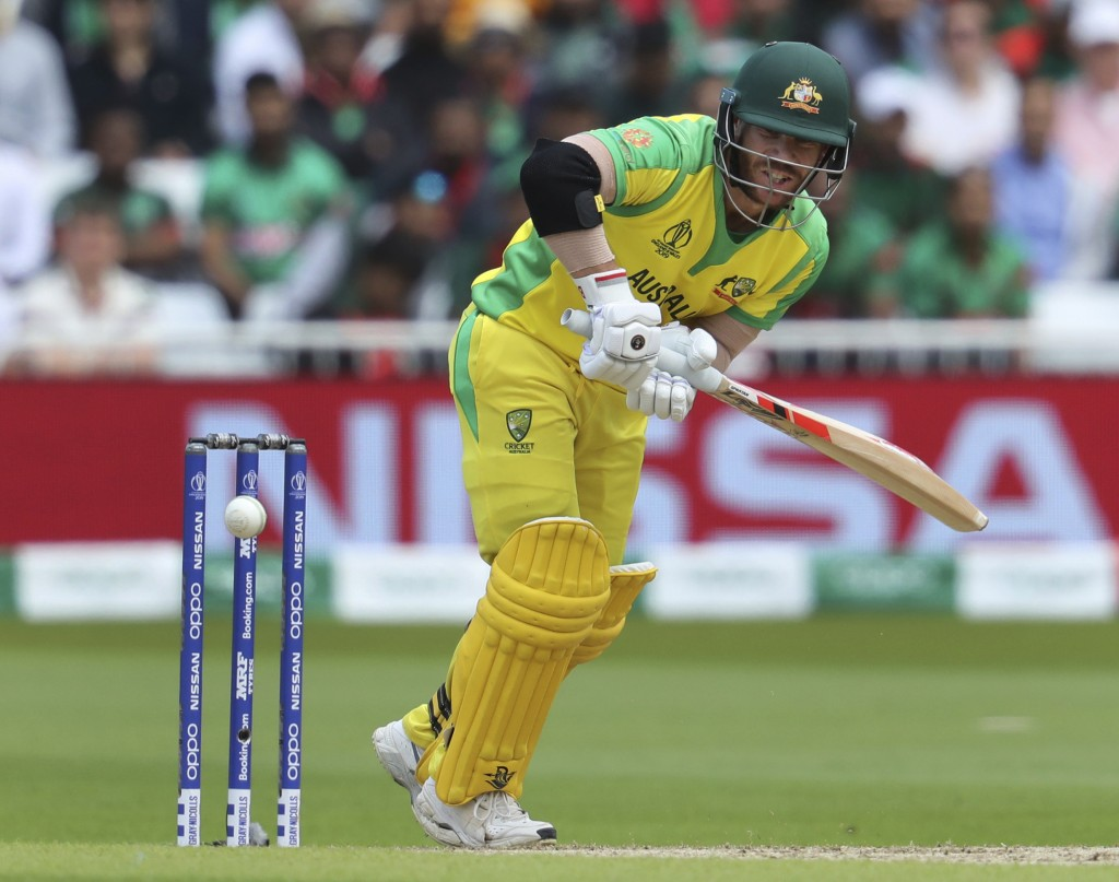 Australia's David Warner plays a shot during the Cricket World Cup match between Australia and Bangladesh at Trent Bridge in Nottingham, Thursday, Jun...