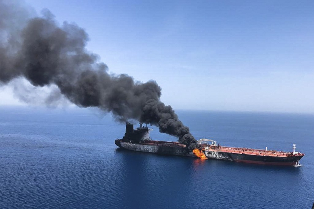 FILE - In this Thursday, June 13, 2019 file photo, an oil tanker is on fire in the sea of Oman. A series of attacks on oil tankers near the Persian Gu...