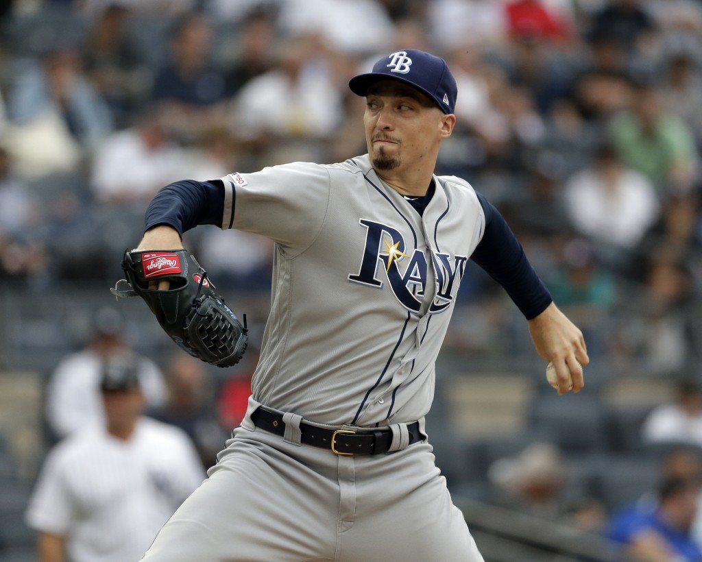 Tampa Bay Rays starting pitcher Blake Snell throws during the first inning of a baseball game against the New York Yankees at Yankee Stadium, Wednesda...