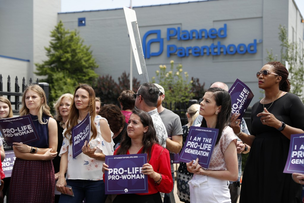 FILE - In this June 4, 2019, file photo, anti-abortion advocates gather outside the Planned Parenthood clinic in St. Louis. Missouri's only abortion c...