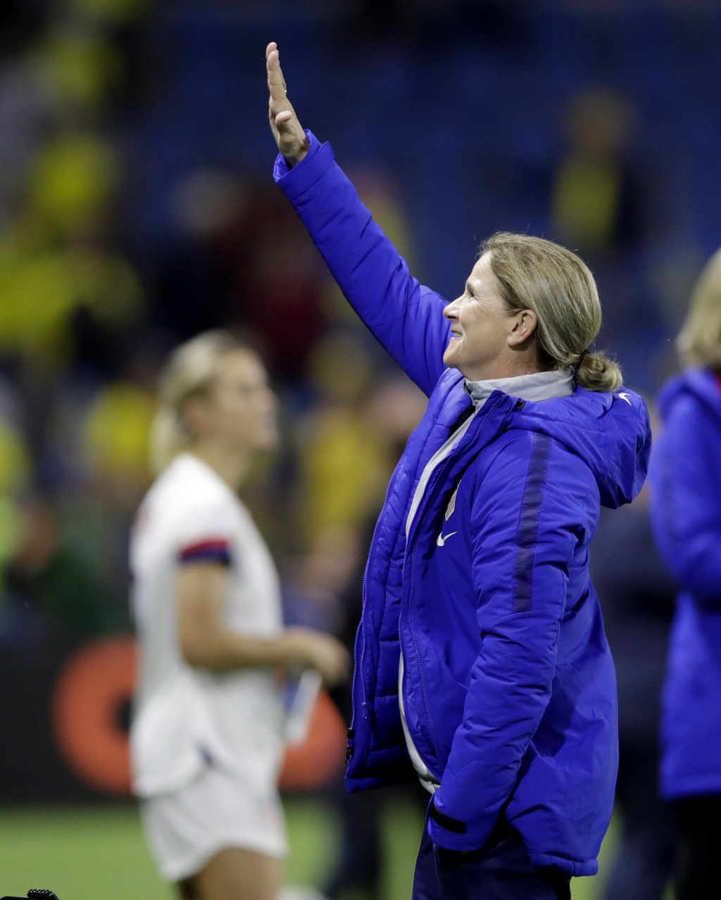 United States coach Jill Ellis waves to the crowd following her team's 2-0 win over Sweden in their Women's World Cup Group F soccer match at Stade Oc...