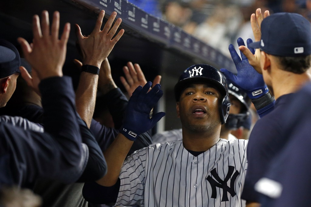 New York Yankees' Edwin Encarnacion celebrates a two-run home run during the seventh inning of the team's baseball game against the Houston Astros on ...