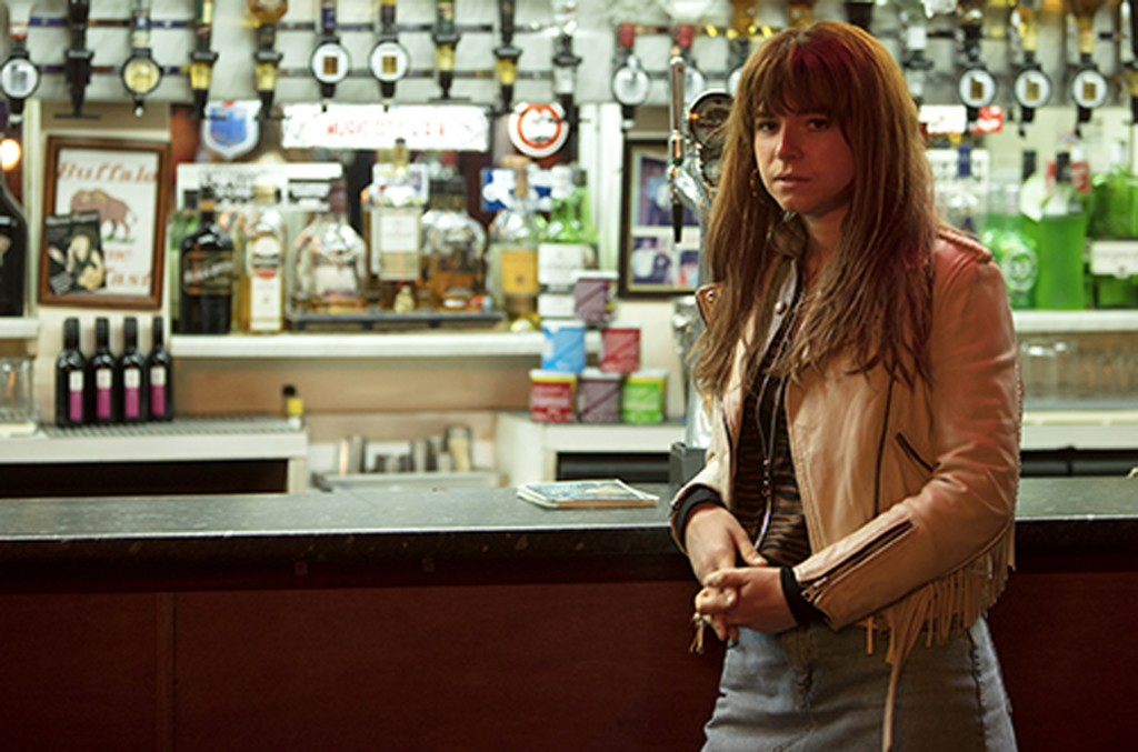 """This image released by Neon shows actress Jessie Buckley in a scene from the film, """"Wild Rose."""" Buckley stars as a fiery, working-class Glasgow single..."""