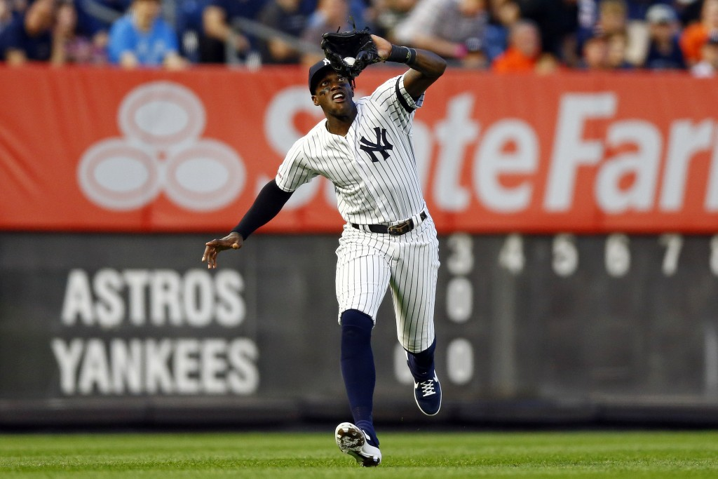 New York Yankees left fielder Cameron Maybin catches a fly ball by Houston Astros' Yordan Alvarez dduring the fourth inning of a baseball game Thursda...