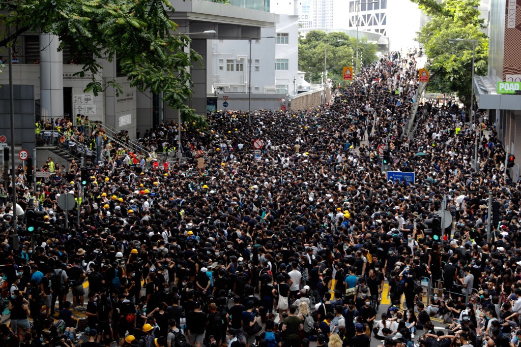 In this Friday, June 21, 2019, file photo, protesters gather outside the police headquarters in Hong Kong. Several hundred mainly student protesters g...