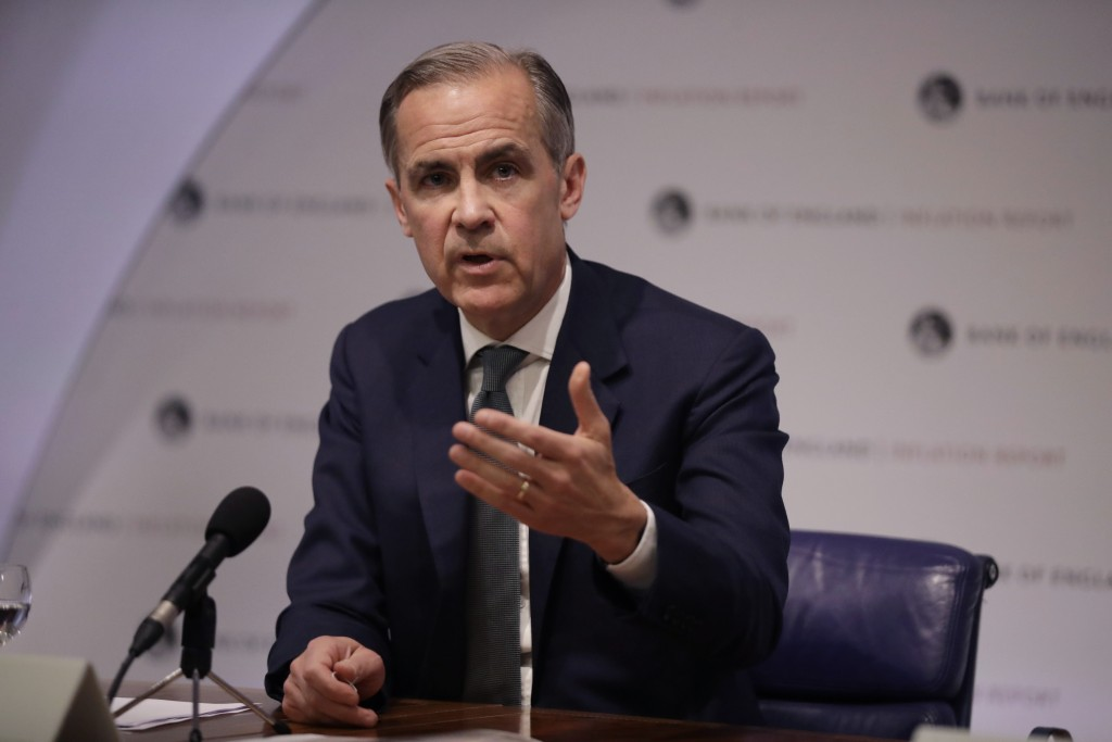 FILE - In this May 2, 2019, file photo Mark Carney the Governor of the Bank of England speaks during an Inflation Report Press Conference at the Bank ...