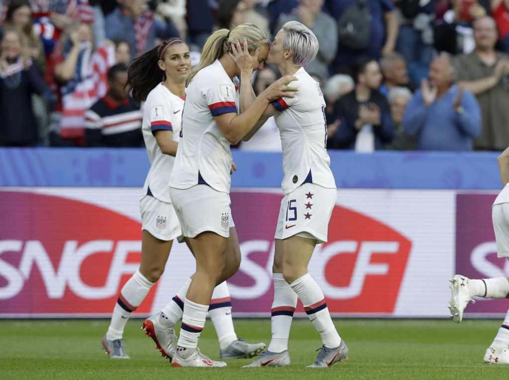 United States' Megan Rapinoe, right, kisses teammate and goal scorer Lindsey Horan during the Women's World Cup Group F soccer match between Sweden an...