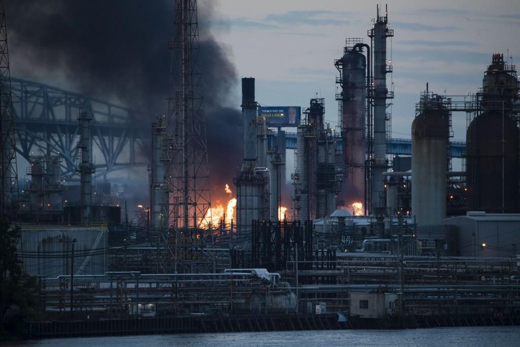Flames and smoke emerge from the Philadelphia Energy Solutions Refining Complex in Philadelphia, Friday, June 21, 2019. (AP Photo/Matt Rourke)
