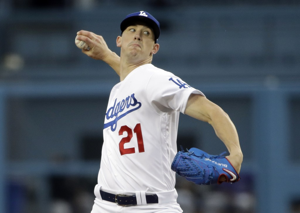 Los Angeles Dodgers starting pitcher Walker Buehler throws to a Colorado Rockies batter during the first inning of a baseball game Friday, June 21, 20...