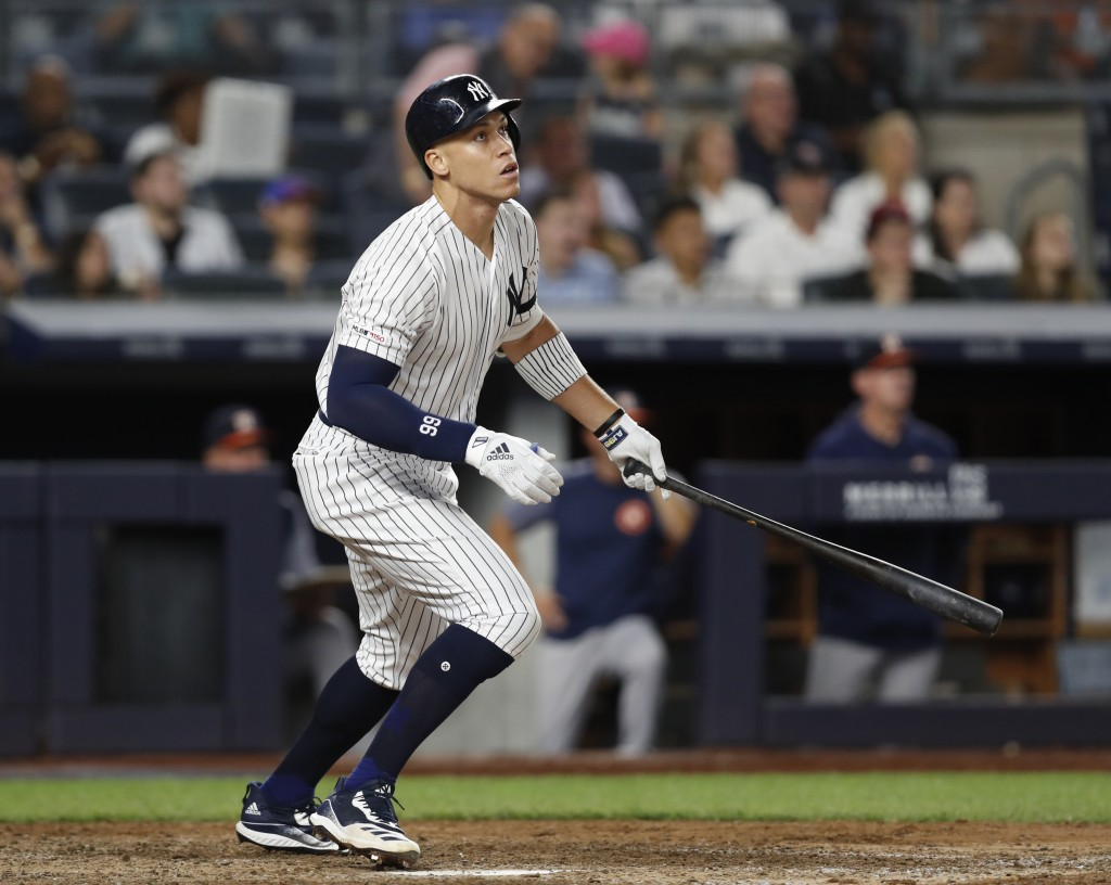 New York Yankees' Aaron Judge watches his fly out to deep left field during the seventh inning of the team's baseball game against the Houston Astros,...