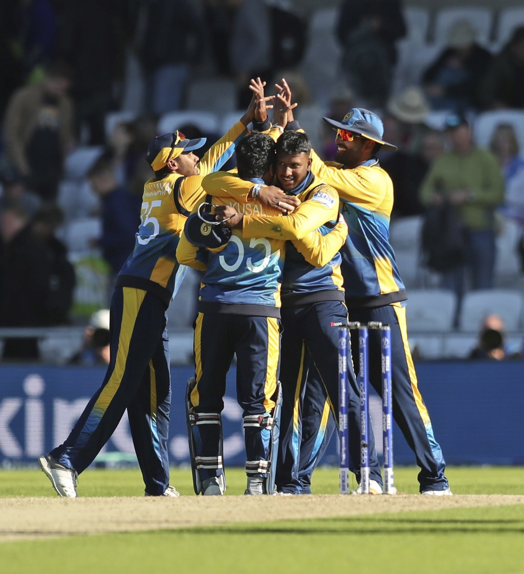 Sri Lankan cricketers celebrate after winning the Cricket World Cup match against England in Leeds, England, Friday, June 21, 2019. (AP Photo/Jon Supe...
