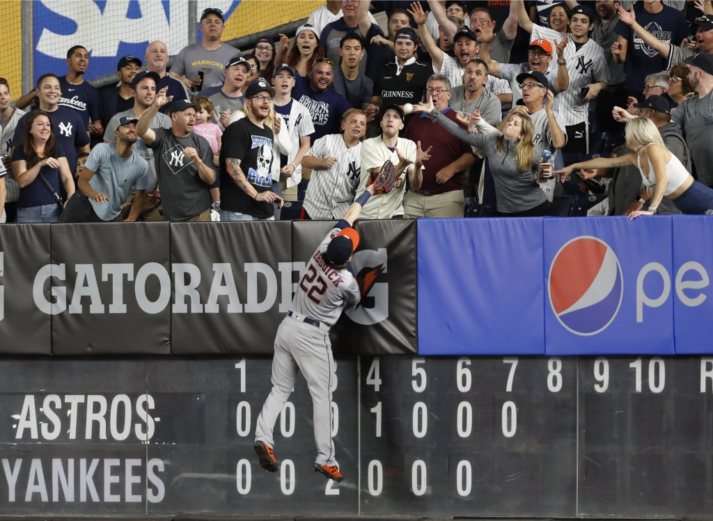Houston Astros right fielder Josh Reddick (22) can't catch a two-run home run by New York Yankees' Gleyber Torres during the seventh inning of a baseb...