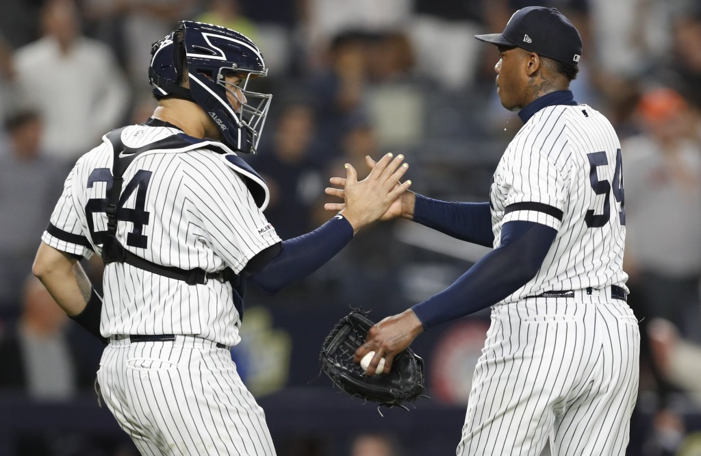 New York Yankees catcher Gary Sanchez (24) congratulates relief pitcher Aroldis Chapman after the Yankees defeated the Houston Astros 4-1 in a basebal...