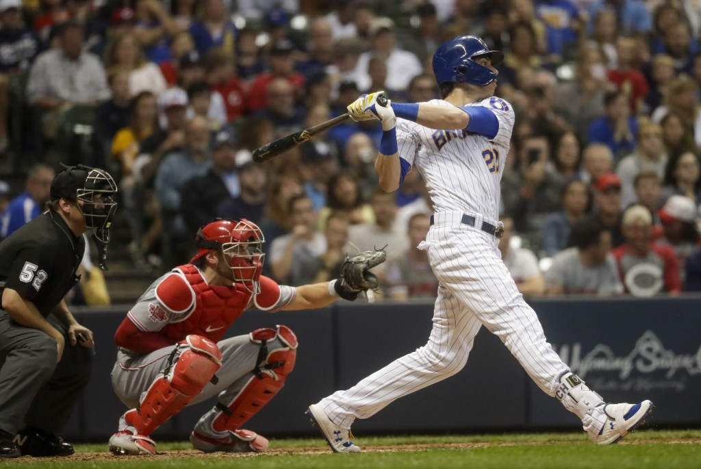 Milwaukee Brewers' Christian Yelich hits a two-run home run during the fifth inning of a baseball game against the Cincinnati Reds Friday, June 21, 20...