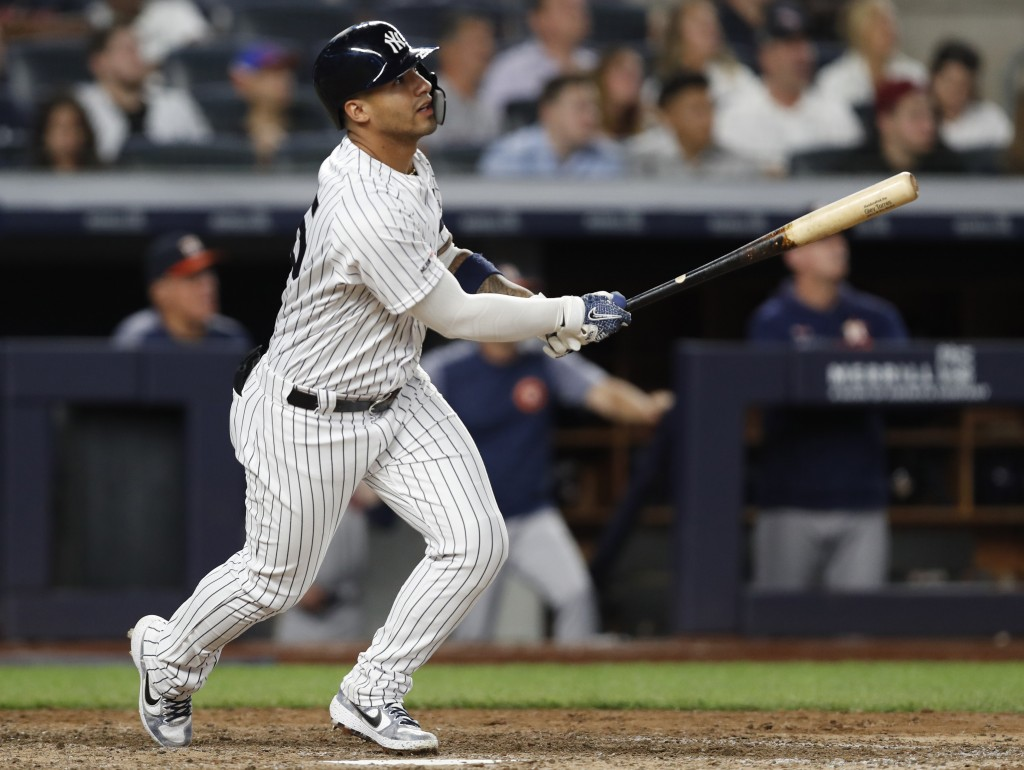 New York Yankees' Gleyber Torres watches his two-run home run during the seventh inning of the team's baseball game against the Houston Astros, Friday...