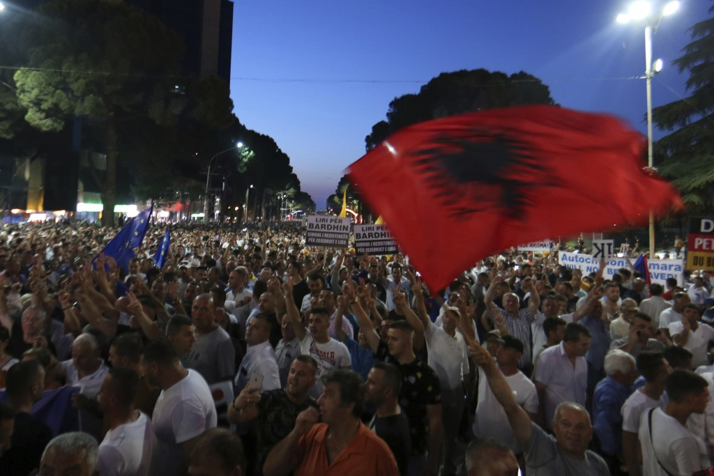 Antigovernment protesters take part in a rally in Tirana, Friday, June 21, 2019. The opposition is boycotting the local elections planned for June 30 ...