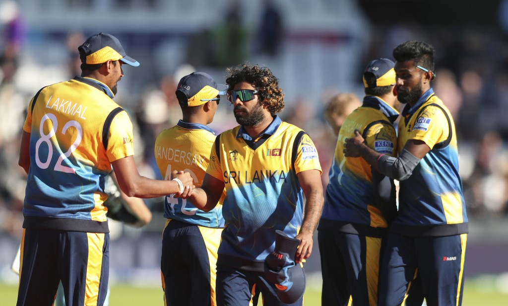 Sri Lanka's Lasith Malinga greets teammates after winning the Cricket World Cup match against England in Leeds, England, Friday, June 21, 2019. (AP Ph...