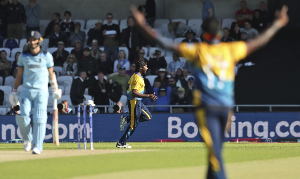 Sri Lanka's Nuwan Pradeep, center, celebrates after taking the last wicket to win the Cricket World Cup match against England in Leeds, England, Frida...