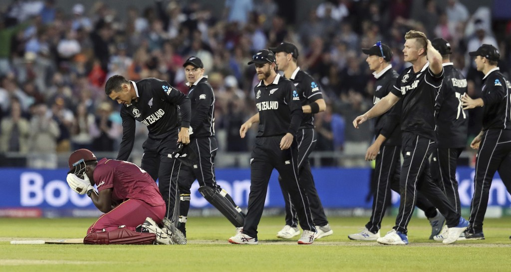 New Zealand's Ross Taylor consoles West Indies' Carlos Brathwaite at the end of the Cricket World Cup match between New Zealand and West Indies at Old...