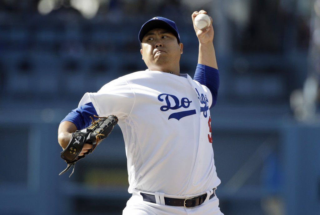 Los Angeles Dodgers starting pitcher Hyun-Jin Ryu throws to a Colorado Rockies batter during the second inning of a baseball game Saturday, June 22, 2...