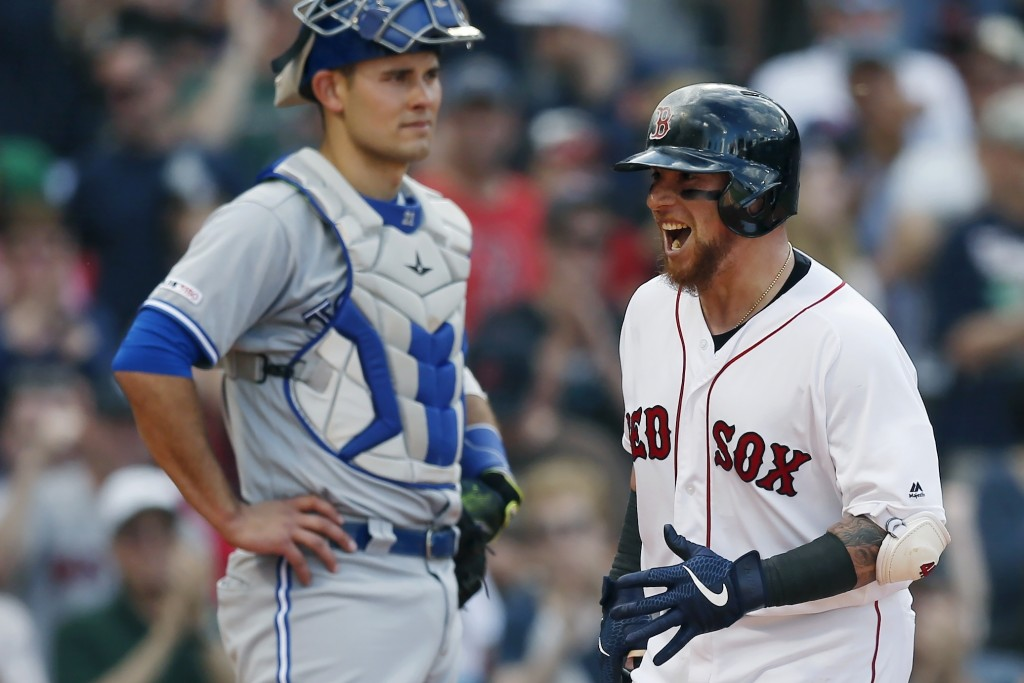 Boston Red Sox's Christian Vazquez, right, celebrates his solo home run in front of Toronto Blue Jays' Luke Maile during the third inning of a basebal...