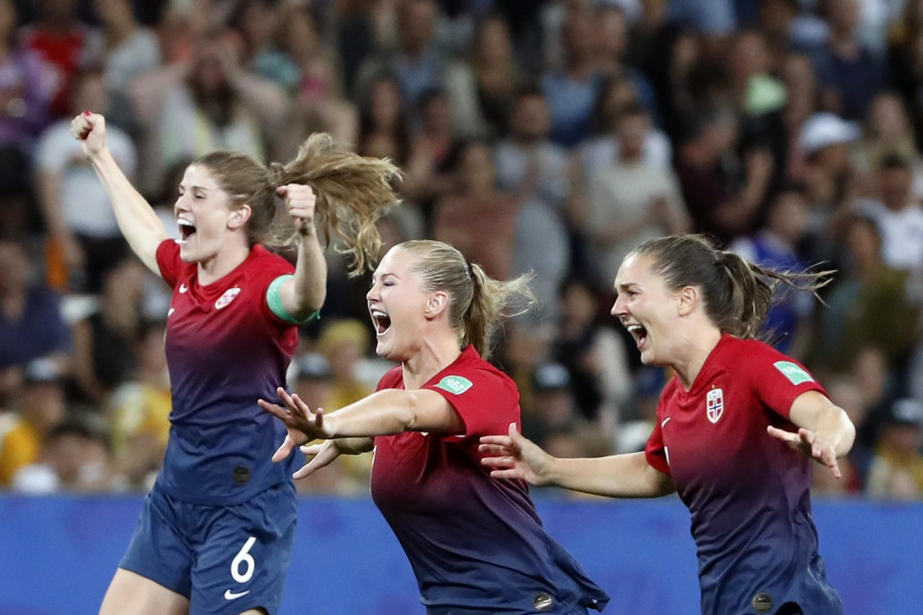 Norway's Maren Mjelde, left, Lisa-Marie Utland, center, and Vilde Boe Risa celebrate after winning the penalty shoot-out of the Women's World Cup roun...