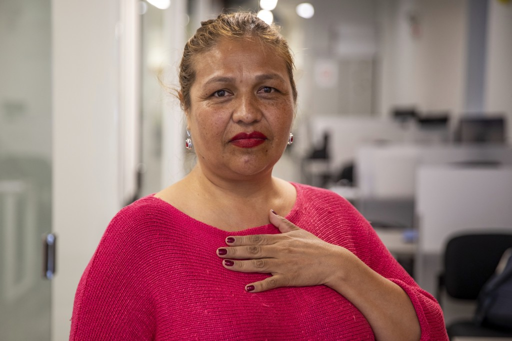 In this Wednesday, June 19, 2019 photo, immigration activist, Julieta Bolivar, poses for a portrait at The Resurrection Project offices in Chicago's P...
