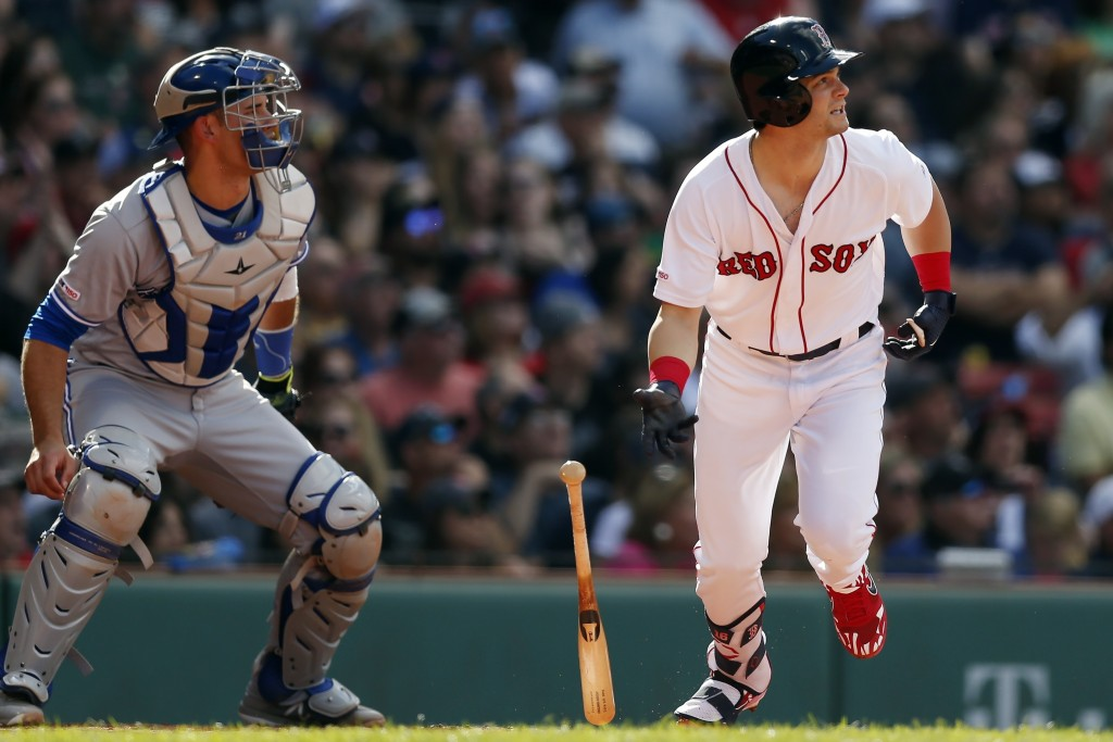Boston Red Sox's Andrew Benintendi watches his two-run double in front of Toronto Blue Jays' Luke Maile during the second inning of a baseball game in...