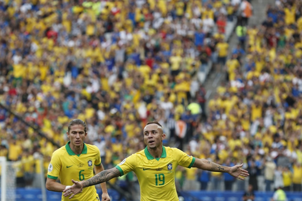 Brazil's Everton celebrates scoring his side's third goal against Peru during a Copa America Group A soccer match at the Arena Corinthians in Sao Paul...