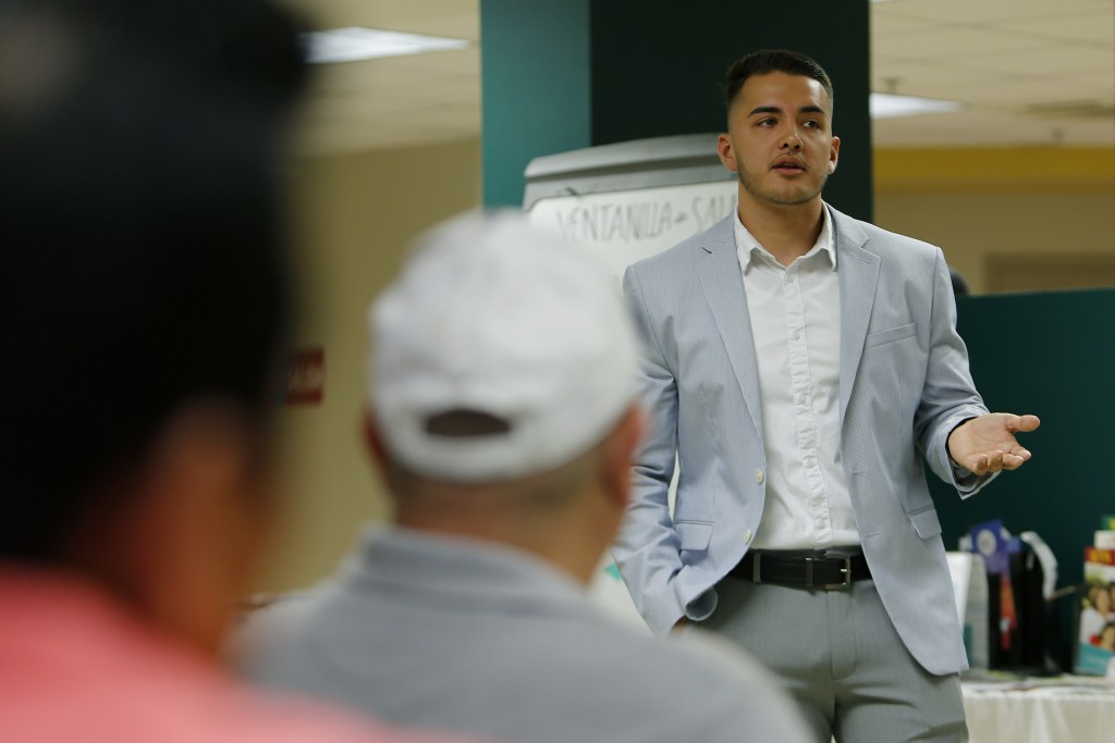 In this Thursday, June 20, 2019 photo, Mauricio Salas, vice president of public relations for Hines Law, speaks about immigrants' rights during a pres...