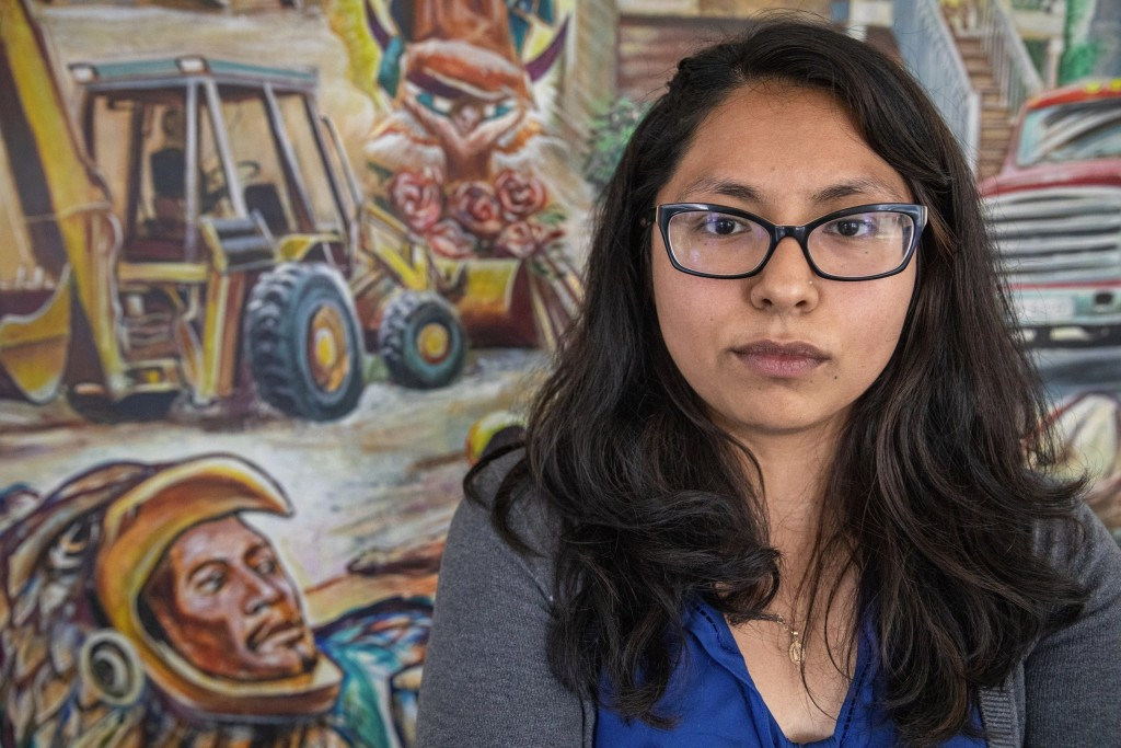 In this Wednesday, June 19, 2019 photo, immigration activist, Laura Mendoza poses for a portrait at The Resurrection Project facility in Chicago's Pil...