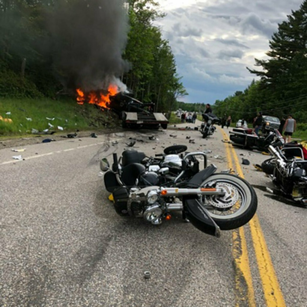 This photo provided by Miranda Thompson shows the scene where several motorcycles and a pickup truck collided on a rural, two-lane highway Friday, Jun...
