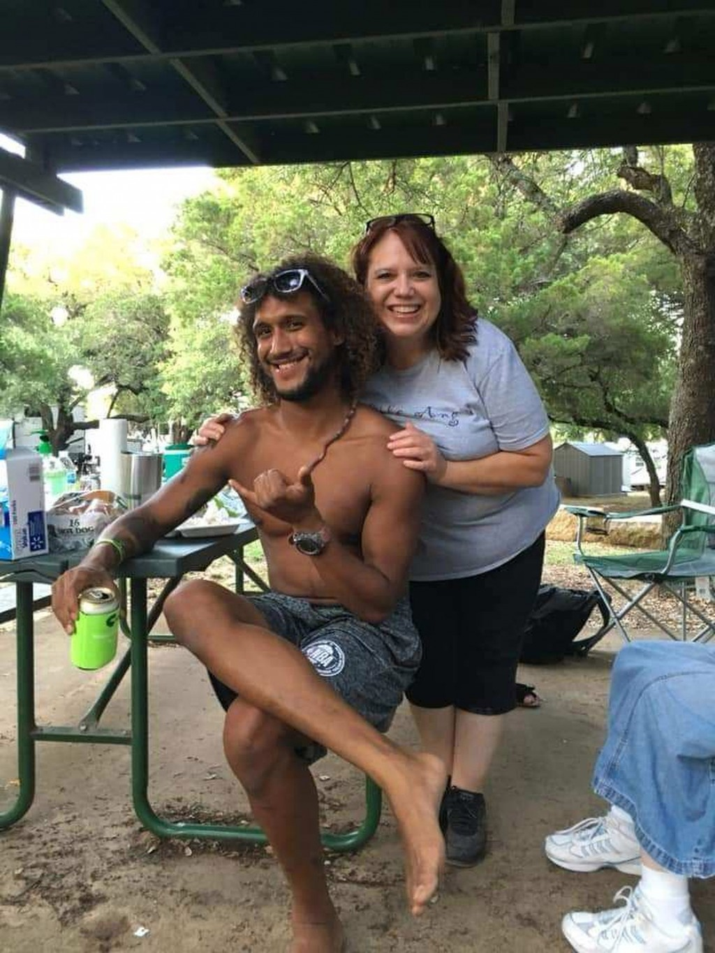 This June 2019 photo provided by Natacha Mendenhall shows Casey Williamson, left, and his mother Carla Ajaga in Possum Kingdom Lake, Texas. Mendenhall...