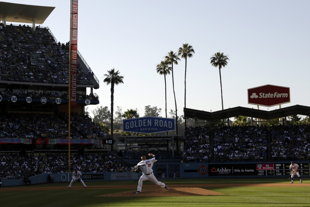 Los Angeles Dodgers starting pitcher Hyun-Jin Ryu throws to a Colorado Rockies batter during the fifth inning of a baseball game Saturday, June 22, 20...