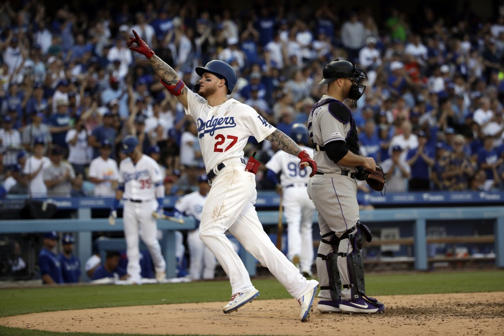 Los Angeles Dodgers' Alex Verdugo (27) celebrates after scoring on his home run, ntext to Colorado Rockies catcher Chris Iannetta during the fifth inn...