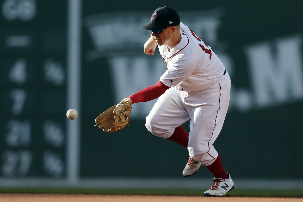Boston Red Sox's Brock Holt fields a groundout by Toronto Blue Jays' Randal Grichuk during the sixth inning of a baseball game in Boston, Saturday, Ju...